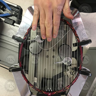 Badminton racquet being strung in our Calgary store.