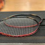 A pair of Yonex Astrox 88D Badminton Racquets strung with BG80 Power.