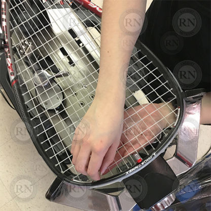 Racquetball racquet being strung in our Calgary store.