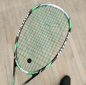 Squash racquet with broken string
